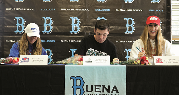 Grace Saad, Trevor Smentek and Marissa Saucedo sign their scholarship documents on Feb 5, 2020 at the Buena High School Library in front of faculty, family and friends.