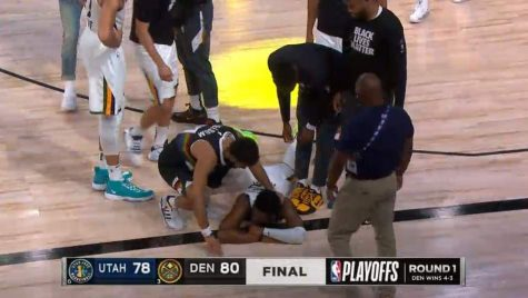 "Utah Jazz Guard Donovan Mitchell, lays on the floor next to Denver Nuggets Guard Jamal Murray, after a heartbreaking defeat to the Denver Nuggets on Sep. 1 in the NBA ""Bubble""."