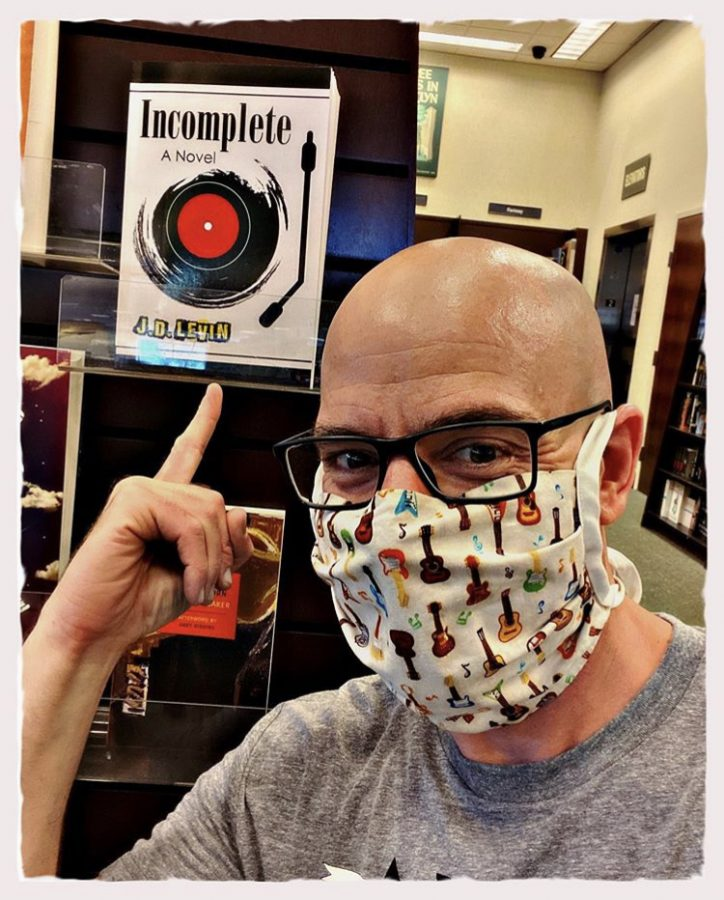 Joel Levin taking a selfie on Instagram with his newly stocked book,