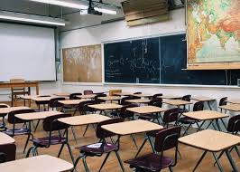 Empty classroom represents the students not being able to return to in-person learning.