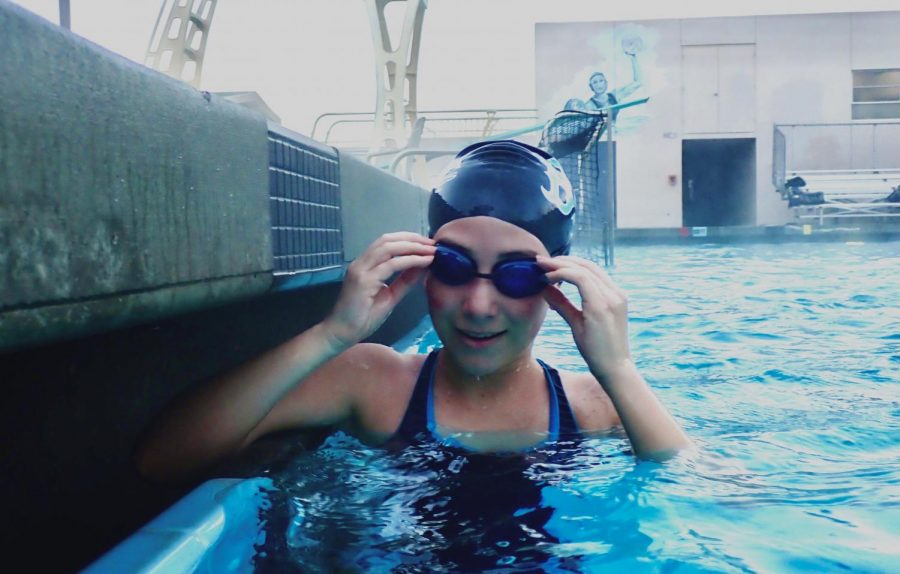 New swimmer Morgan Velasco takes a short break for a picture during morning practice.