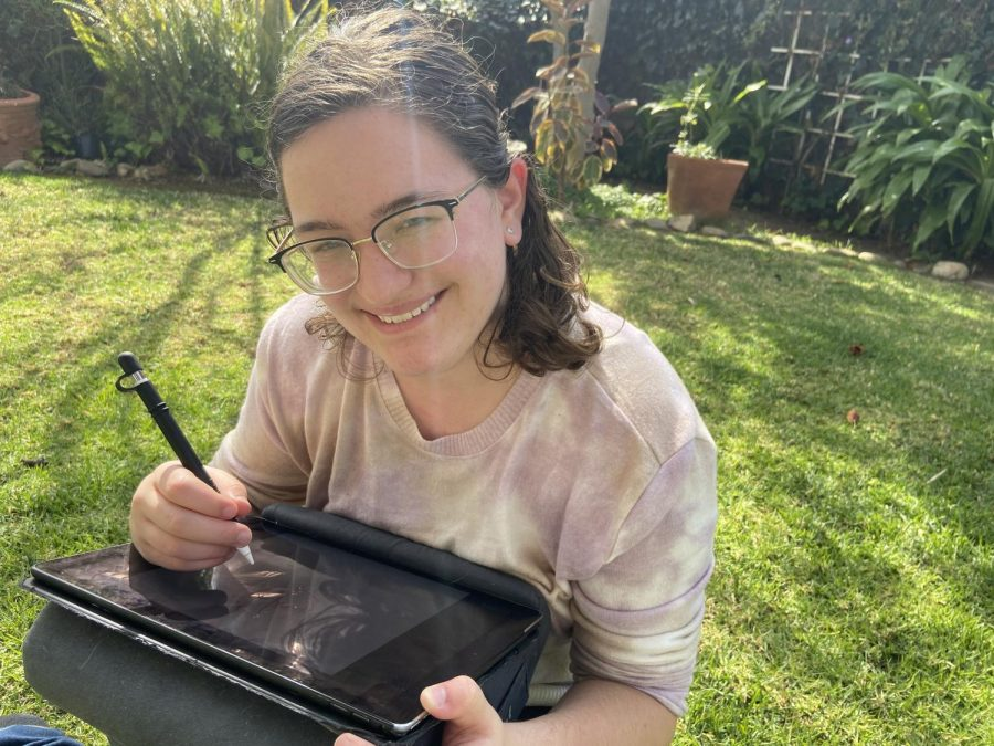 Photo of Hope Stewart drawing on her iPad Pro (12.9 inches) outside on a bright sunny day.