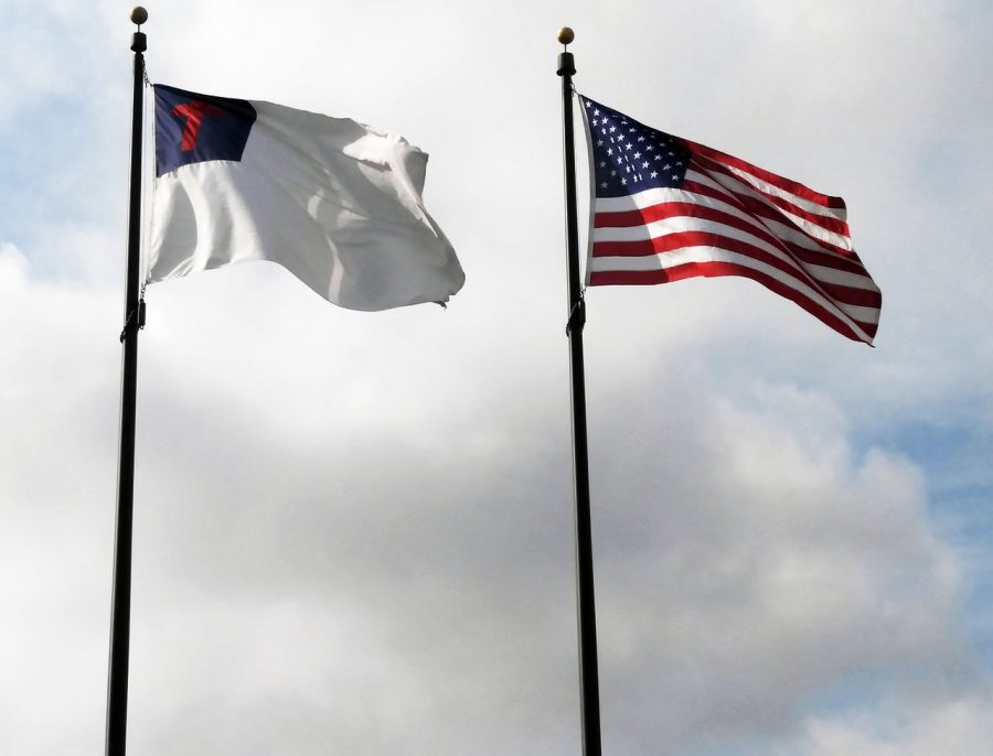 The Christian flag flying next to the American flag, symbolizing the religious freedoms in America.