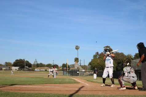 Jacob Martinez battering-up for next pitch.